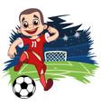 cheerful boy in sportswear plays football vector image
