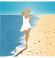 girl in a dress walking on the beach vector image vector image