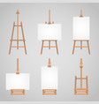 set canvases standing on wooden vector image