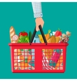 plastic shopping basket full of groceries products vector image vector image