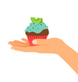 hand holding cupcake with kiwi vector image vector image