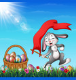 cartoon easter bunny holding red flag with a baske vector image