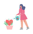 young woman watering heart growing in flower pot vector image