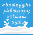 milk font with latin letters white milk hand vector image