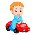 baby boy plays with a toy car vector image vector image