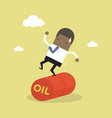 businessman balancing on oil barrel rolling vector image