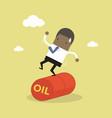 businessman balancing on oil barrel rolling vector image vector image