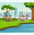 happy children playing tug war in city park vector image