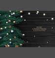 Christmas tree branch decorated with gold bubbles