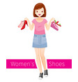 woman holding shoes she wearing short jean skirt vector image