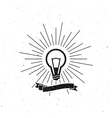 light bulb label with ribbon and light rays vector image