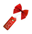 christmas sale tag with red bow vector image vector image