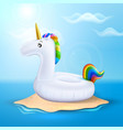 unicorn inflatable pool ring on beach vector image