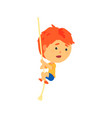 redhead boy climbing up the rope kids physical vector image vector image