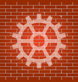 gear sign whitish icon on brick wall as vector image vector image