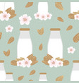 seamless pattern with bottles of almond milk vector image vector image