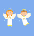 praying couple girl and boy with wings vector image vector image