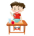 boy eating from bowl on the table vector image
