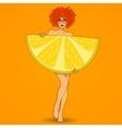Pretty redhead woman poses with big lemon