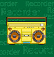 old yellow cassette tape recorder with cassette vector image