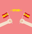 spain national day with hands holding up spain vector image vector image
