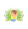 smiling happy boy sitting in green grass adorable vector image vector image