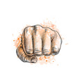 fist from a splash of watercolor vector image vector image