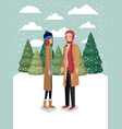 couple of women in snowscape with winter clothes vector image vector image