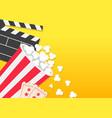 movie reel open clapper board popcorn bucket box vector image vector image
