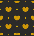 Tile pattern with golden hearts and dots on black