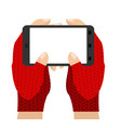 hands in mittens hold phone winter gloves and vector image
