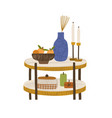 small wooden coffee table with vase and candles vector image vector image