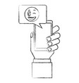hand with smartphone chatting winking emoji hand vector image vector image
