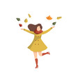 young woman throwing leaves up wearing autumn vector image vector image