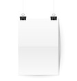 Sheet of paper folded in two hangs on binder clips vector image vector image