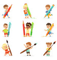 smiling young boys and girls holding big pencils vector image vector image