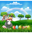 happy bunny holding a decorated easter egg vector image vector image
