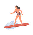 active female in swimsuit standing on surfboard vector image vector image