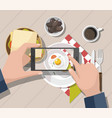 man taking photos of food on the smartphone vector image vector image