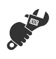 hand holding wrench glyph icon vector image vector image