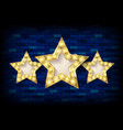 three golden stars against a brick wall vector image vector image