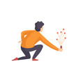 young man launching fireworks rocket with sparkles vector image vector image