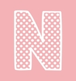 N alphabet letter with white polka dots on pink vector image vector image