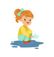 sweet little girl playing with paper boat in a vector image vector image