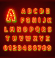 Red fluorescent neon font on dark background