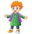 cartoon happy boy in green winter clothes vector image vector image