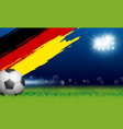 soccer ball on grass and paintbrush germany flag vector image vector image