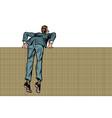 man climbs over wall vector image vector image