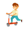 happy little boy rides kick scooter isolated vector image