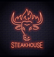 bull head neon logo steakhouse bull with fire vector image vector image